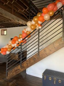 Organic balloon handrail decor