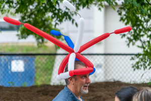 A happy customer with a balloon hat. One of my favorite things to twist.